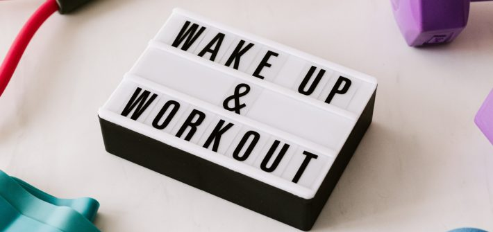 A sign that says Wake up and Workout.