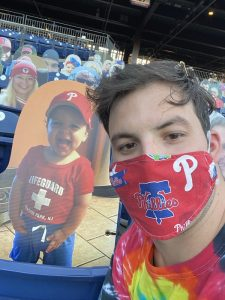 Paul wearing a Phillies mask.
