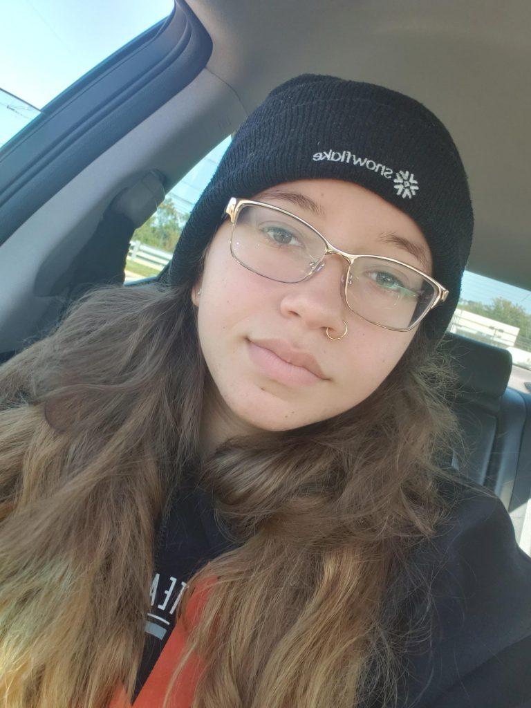Selfie of Alexis in the car.
