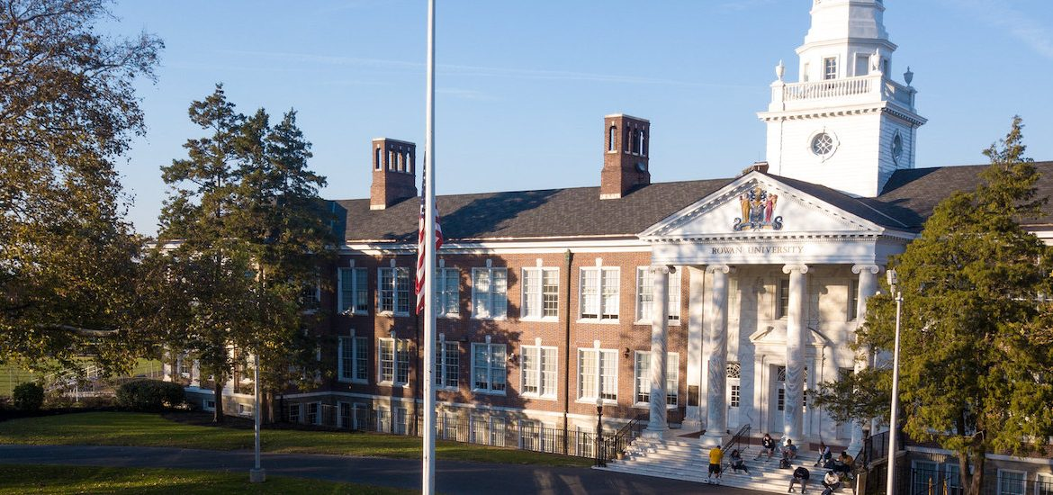 Photo taken by a drone of Bunce Hall with students sitting on the marble steps.