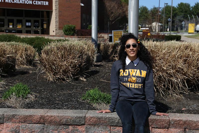 Rachel sitting outside the Rec Center.