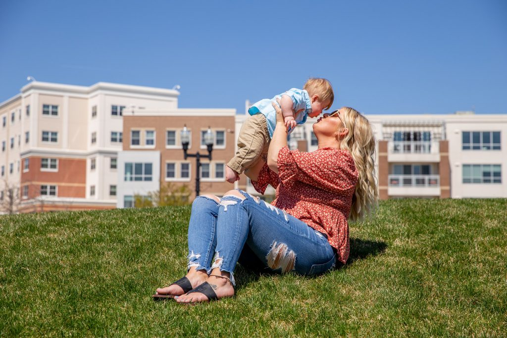 Victoria and Rowen sit on the grass in the Glassboro Town Square.