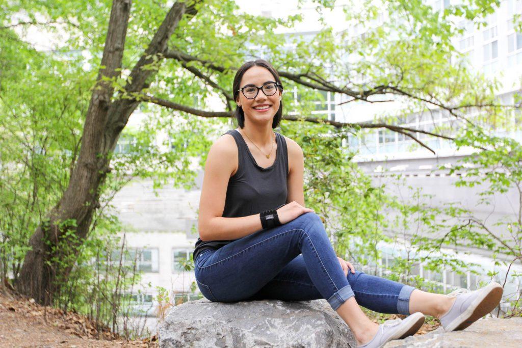 Madison sitting on a rock
