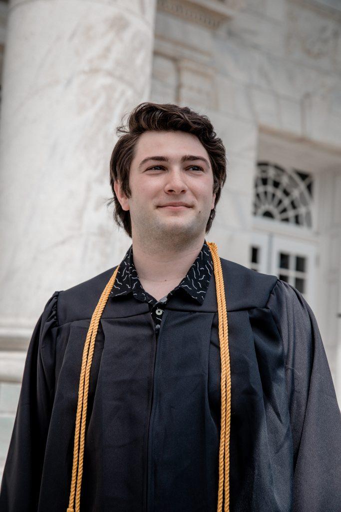 Josh standing at Bunce in his grad gear.
