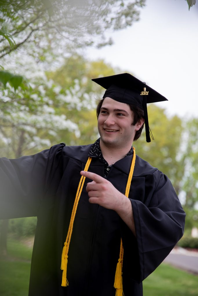 Josh looking to the side in his cap and gown.