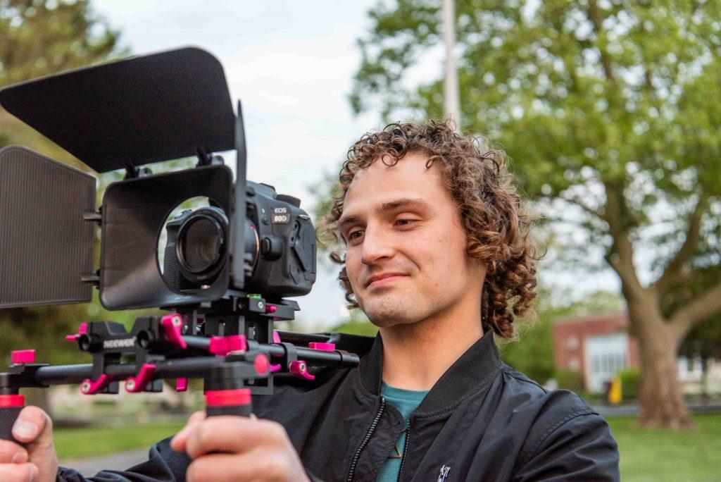 Adam holding up his video camera.