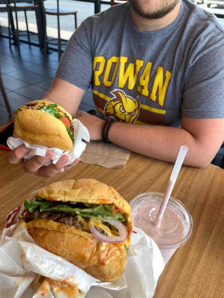 Nick and Jen enjoying burgers and a shake inside Smashburger.