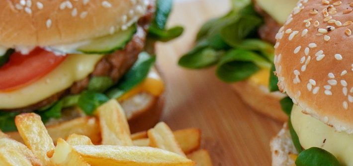 Stock image of burgers with a side of French fries.