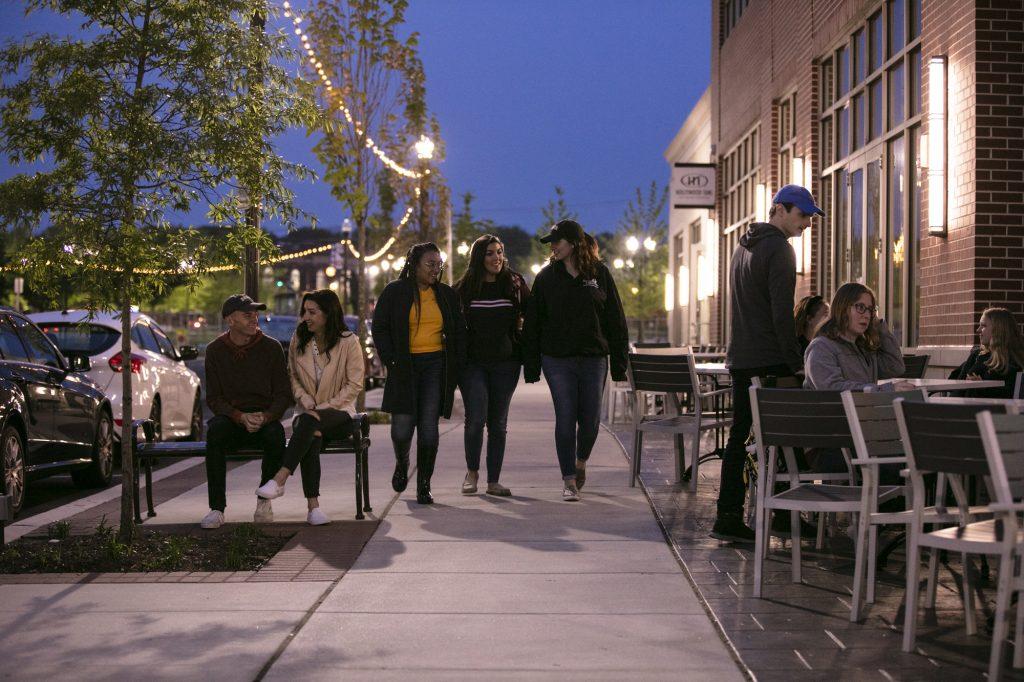 Students walking down Rowan Boulevard at night