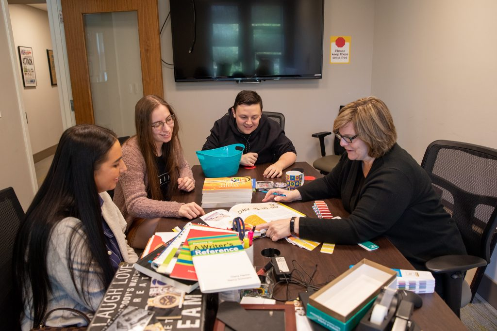 Professor Fagan collaborates with her students.