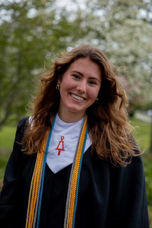 Alexa smiles in her graduation gown.