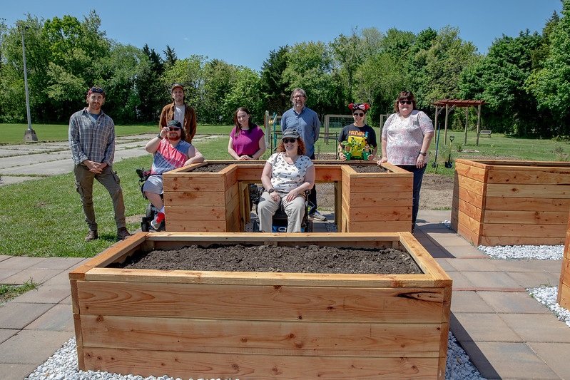 Jenna poses with the Borgersen family, Backyard Gardens LLC and the Sustainable Monroe Township.