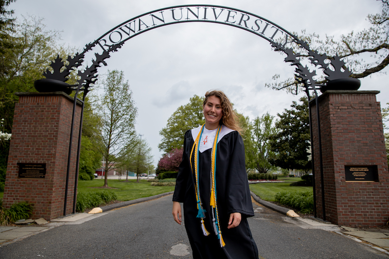 Alexa stands in front of the Rowan arch.