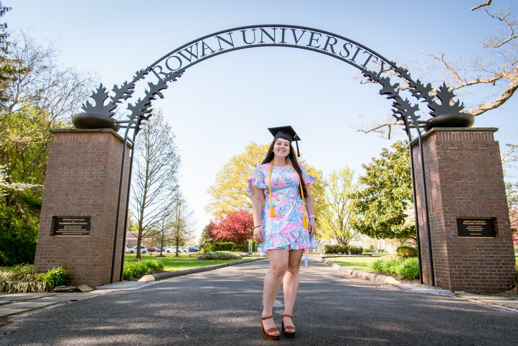 Kassidy poses in front of the Rowan arch.