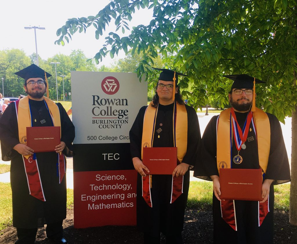 Gregory (left) with his brothers at graduation.