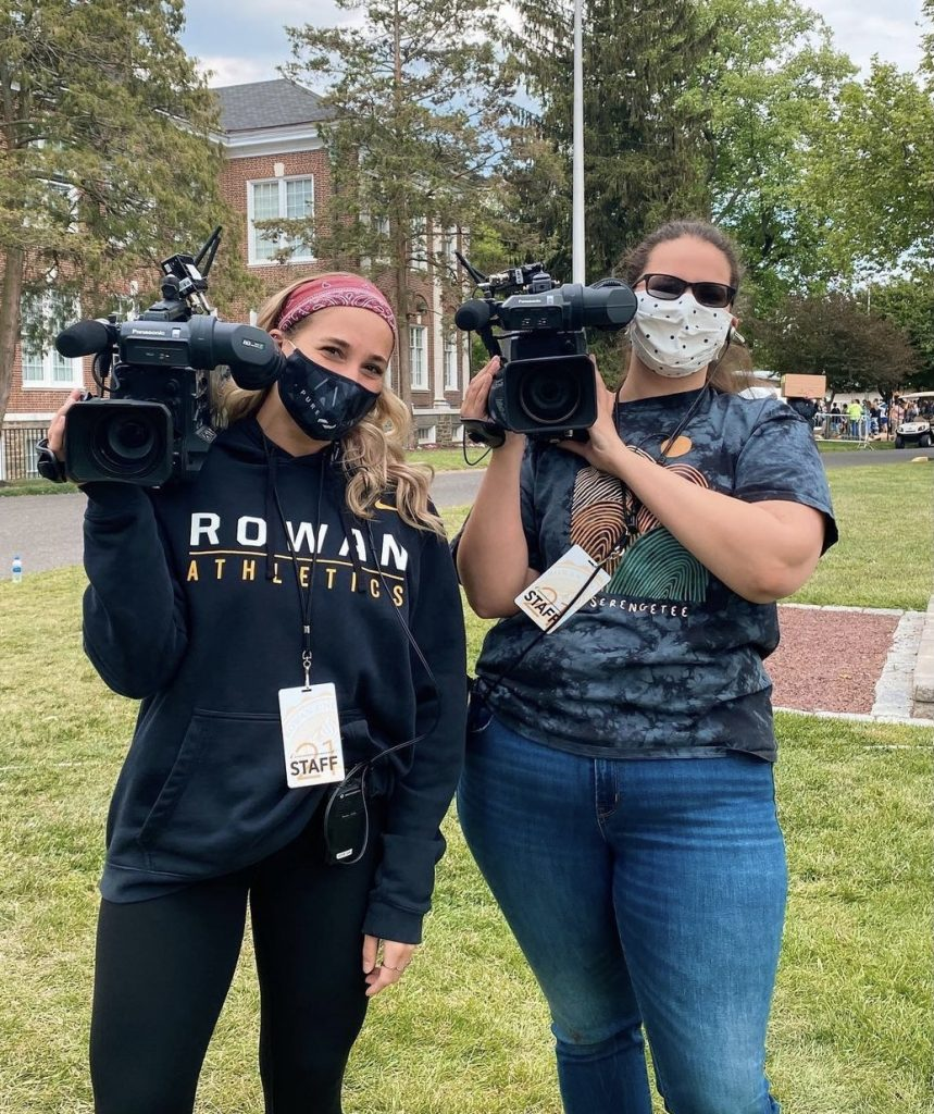 Jade and Chelsea Valcourt film on campus.