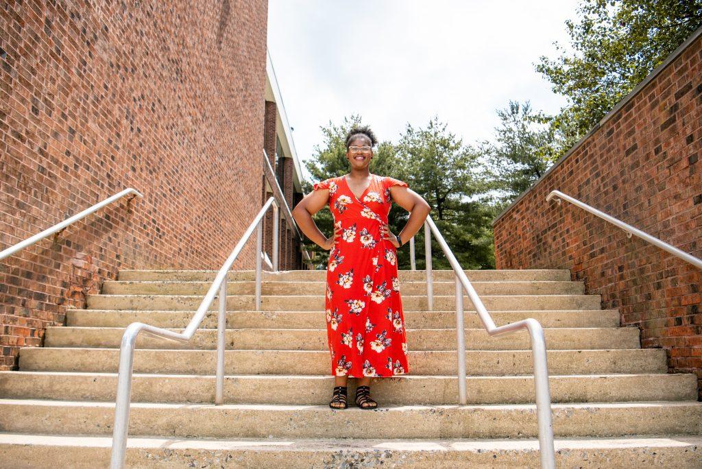 Jocelyn standing on steps.