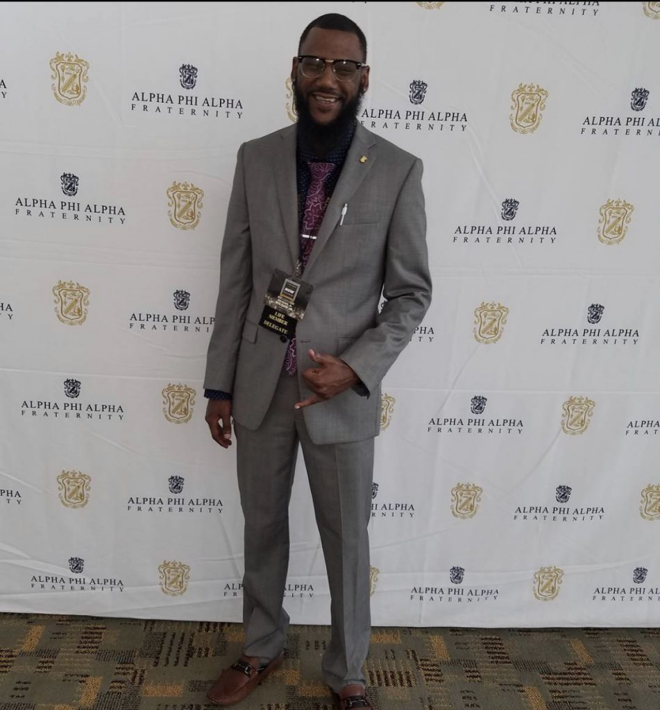Michael at award ceremony for Alpha Phi Alpha Fraternity Incorporated.