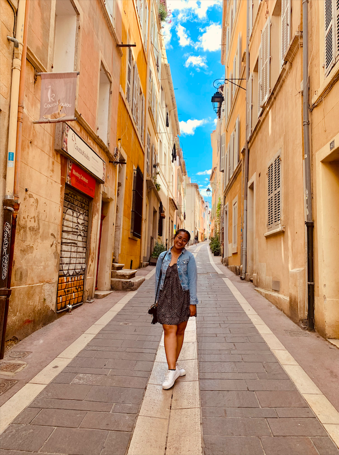 Stephanie poses in a gorgeous, tiny street in the French city of Marseilles.