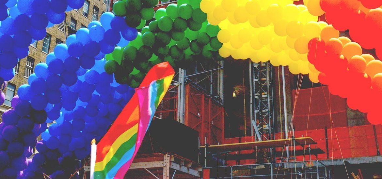 Balloon arch and flag at pride parade