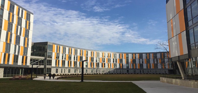 exterior of Holly Pointe Commons, orange, white and gray modern.