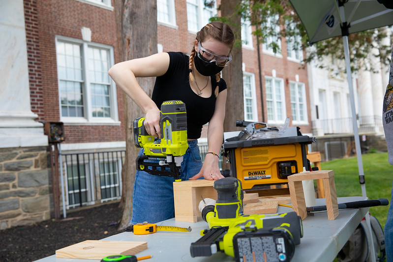 Stagecraft Fundamentals student, Jenna Hope, using power tools in class.