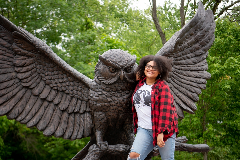 Bianca poses next to the prof statue.