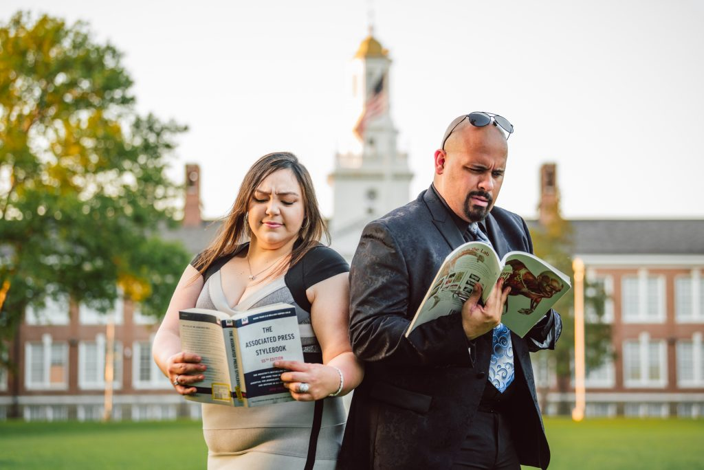 Brandon and his wife looking confused as they read each other's textbooks.
