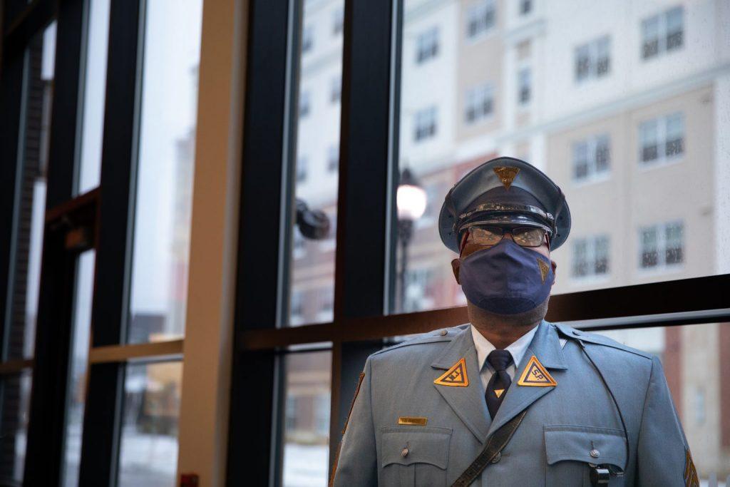 Headshot of Danyel in uniform wearing a mask.
