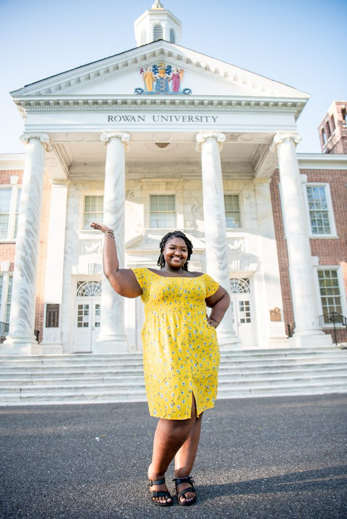 Kayla Tucker standing and smiling in front of Bunce Hall.