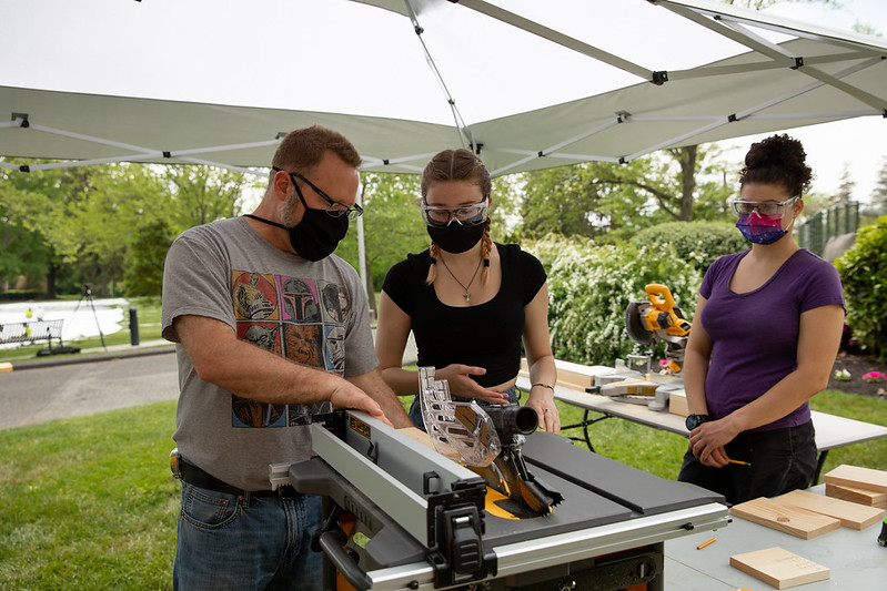 Stage Craft Fundamentals students using a power saw.