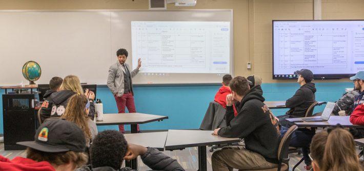 A professor lectures a class.