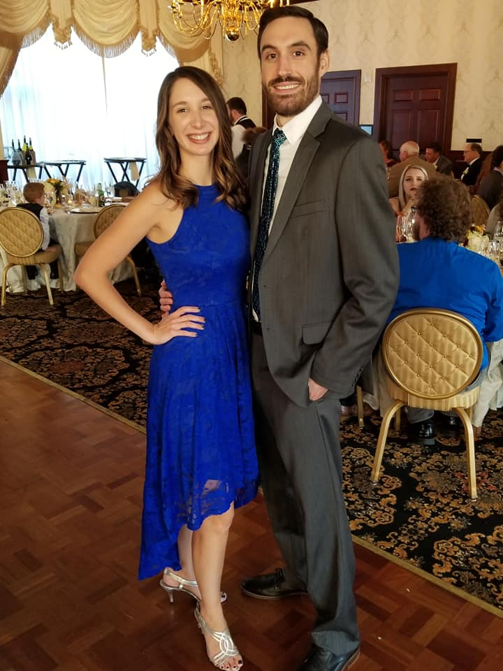 Jake at an event with his spouse.