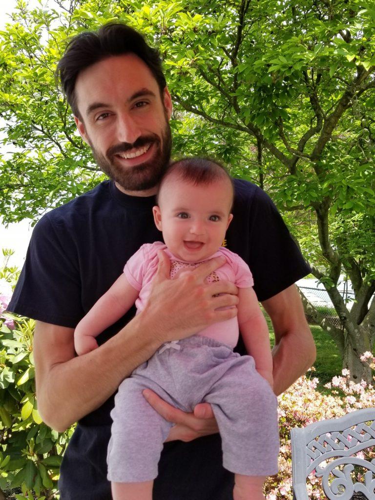 Jake holding his child.