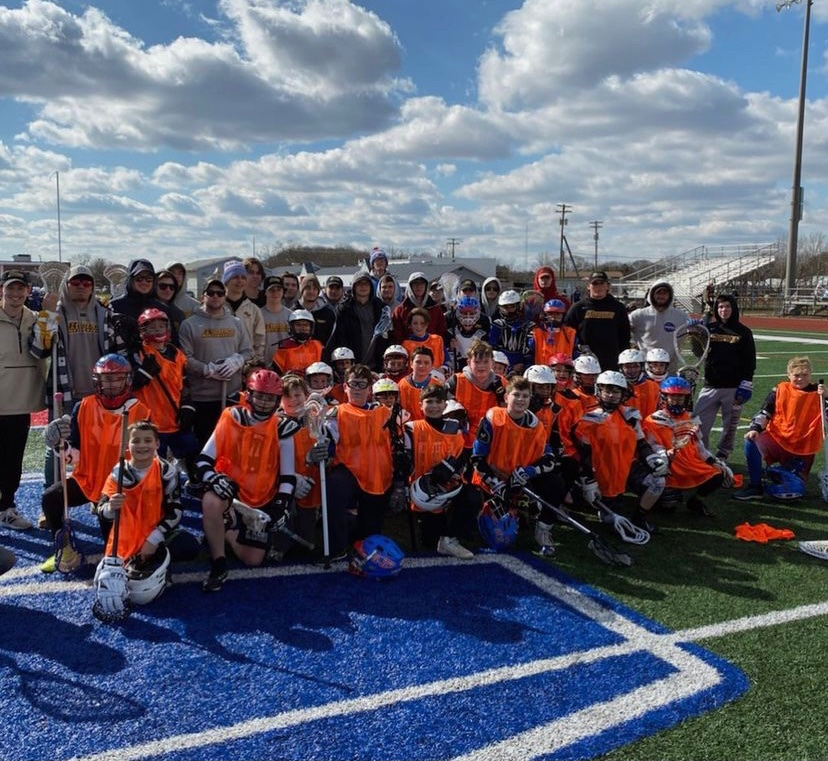 Team volunteering to help the youth players of Washington Township for a clinic.