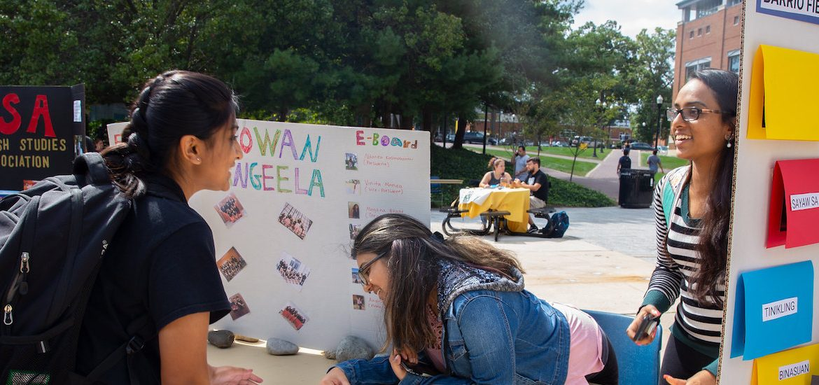 Students check out a club on campus.