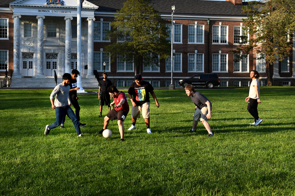Students play soccer on Bunce Green.