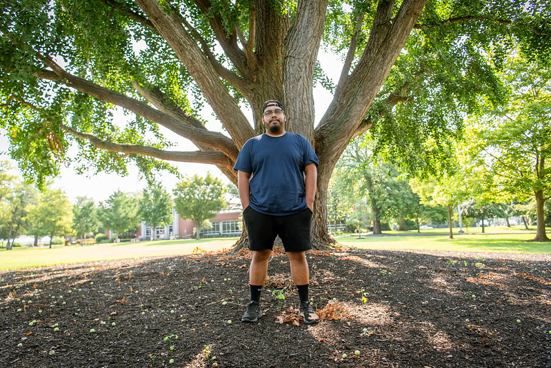 Alex stands in front of a tree on Bunce Green.