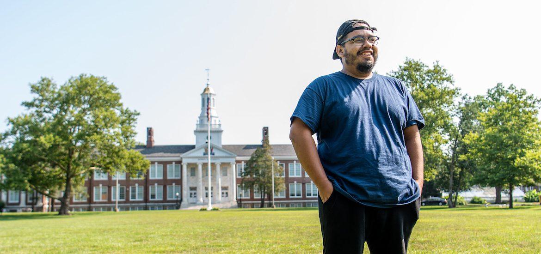 Alex stands on Bunce Green overlooking Bunce Hall.