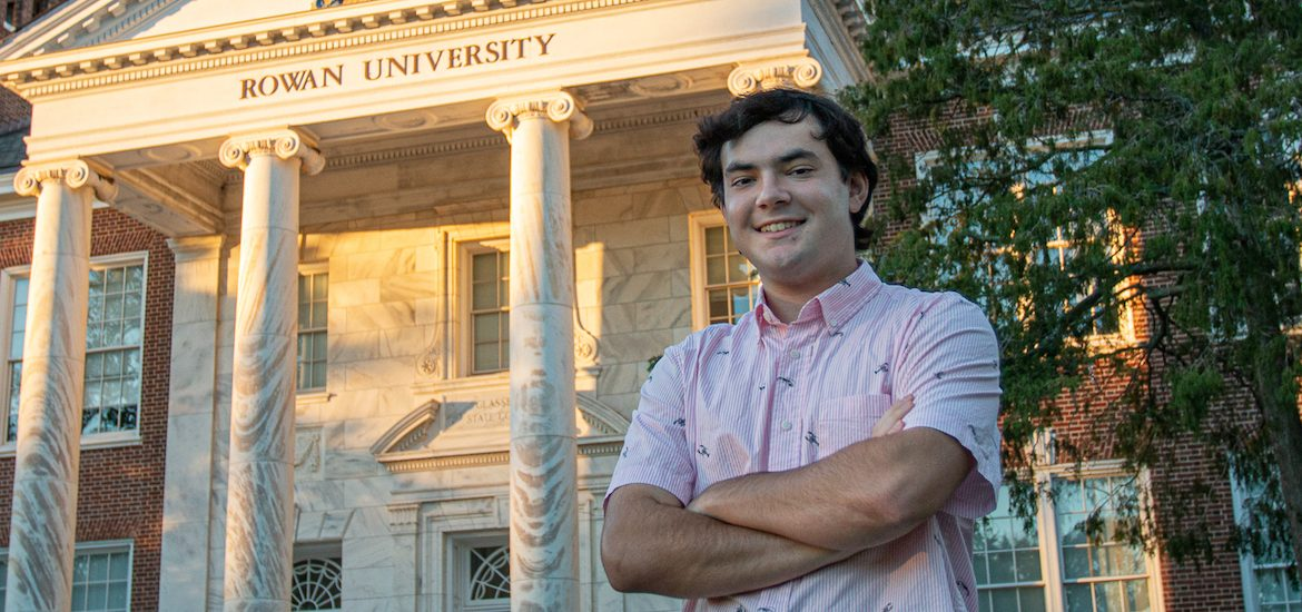 Nick smiles, stands in front of Bunce Hall.